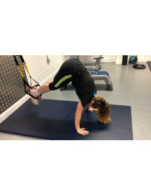 A super-core workout, with legs suspended in a TRX machine