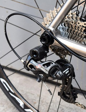 The Campagnolo Super Record rear derailleur has a lacquered carbon finish
