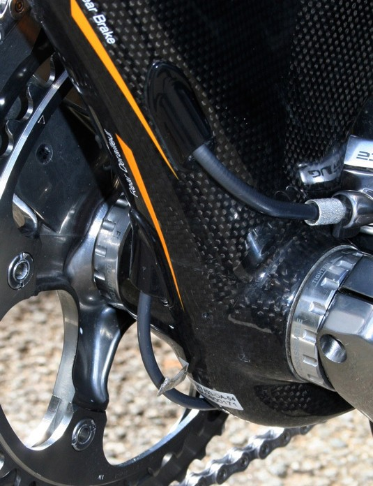 The rear derailleur and rear brake cables emerge beneath the bottom bracket where they are needed.