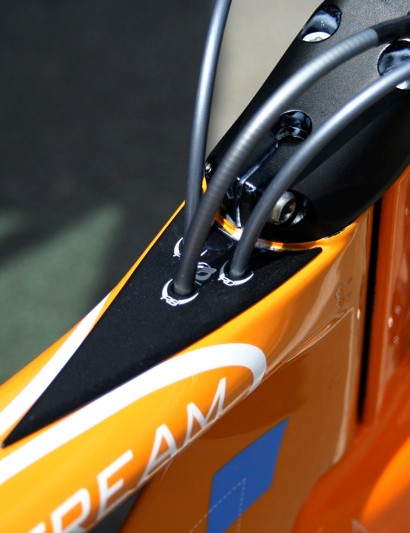 Cables enter the frame behind the stem where the air is already 'dirty'.  MIL-spec o-rings prevent water from entering, too.