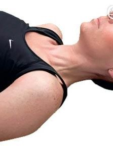 Sore neck? First, lie down flat on the floor with your knees bent