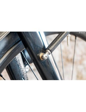 The front rack attaches via mid fork eyelets