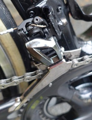 The small Allen key bolt near the top of the mechanism is the cable tension adjuster
