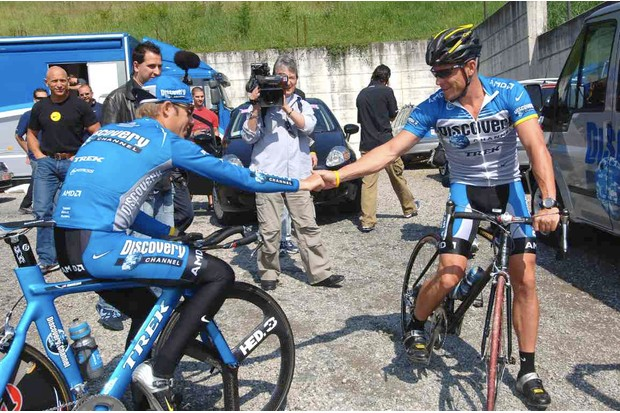 Danielson, trying to soak some Tour energy from Lance's knuckles in 2006.