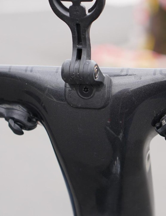 Trek integrates the Garmin holder, but the mechanics use good, old-fashioned electrical tape to tidy up the satellite shifters