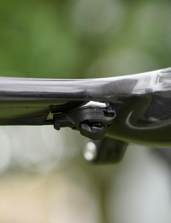 Degenkolb has sprint shifters on the drops and then here underneath the tops near the stem