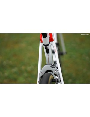 The rear brake cable exits the frame at the seat tube