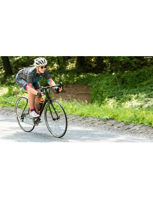 Pedals level, body low, hands on the drops — the ideal descending position