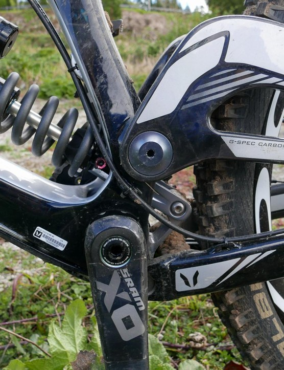 The lower suspension link drives the shock and also pivots around the bottom bracket