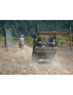 Egger leads a young duo on a tour of his motocross track.