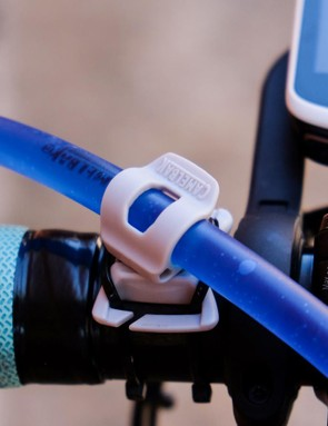 Hauswald modified CamelBak's magnetic hose clamp to keep his water within arm's reach