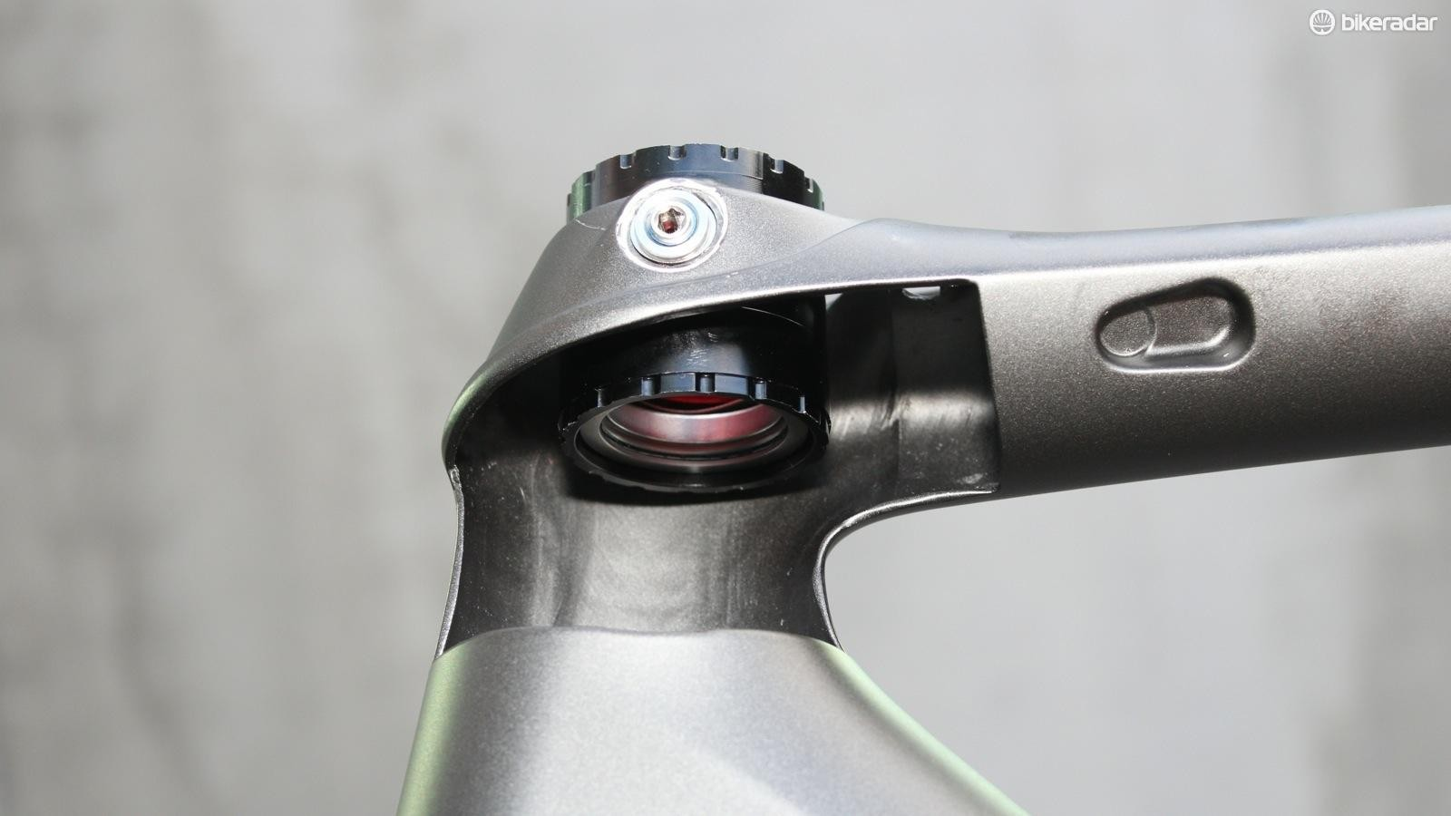 No, it doesn't feel like your headset is loose. The pivot allows for a little fore/aft bowing in the carbon steerer, without feeling sloppy or loose laterally