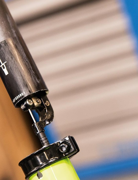 A locking mechanism holds the post in place and a spring pushes the saddle up when the lock is released