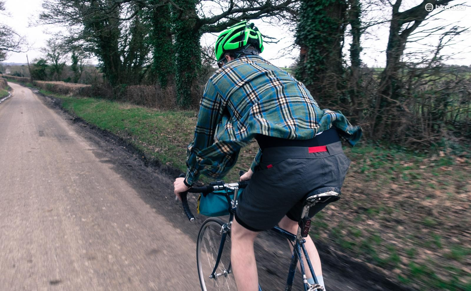 Trendy flannel shirts are mandatory when riding a fixie along back lanes