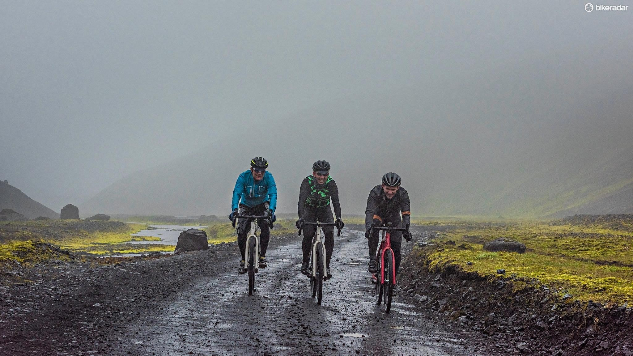 Three bedragled riders, 6 hours in to non-stop wind and rain. Still smiling, just.