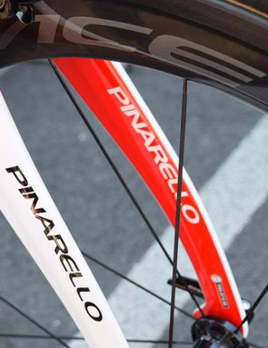 Kwiatkowski's forks are painted red on the inside and white on the outside, with contrasting Pinarello decals on each surface