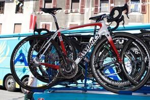 Aru's spare bike sits on the outside of the Astana team car