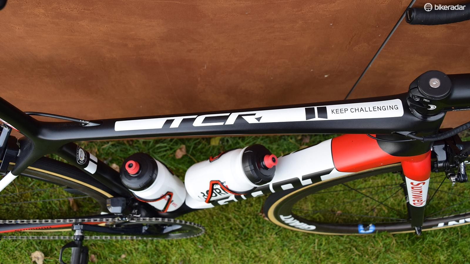 The team's motto adorns the top tube of the bike