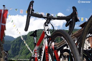 Aru's spare bike is also red and white