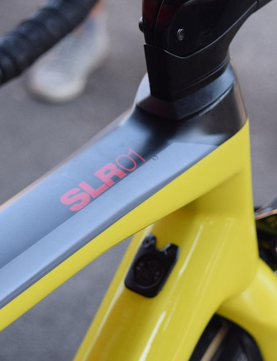 The top tube retains the black, grey and red detailing seen on a standard team-issue frameset