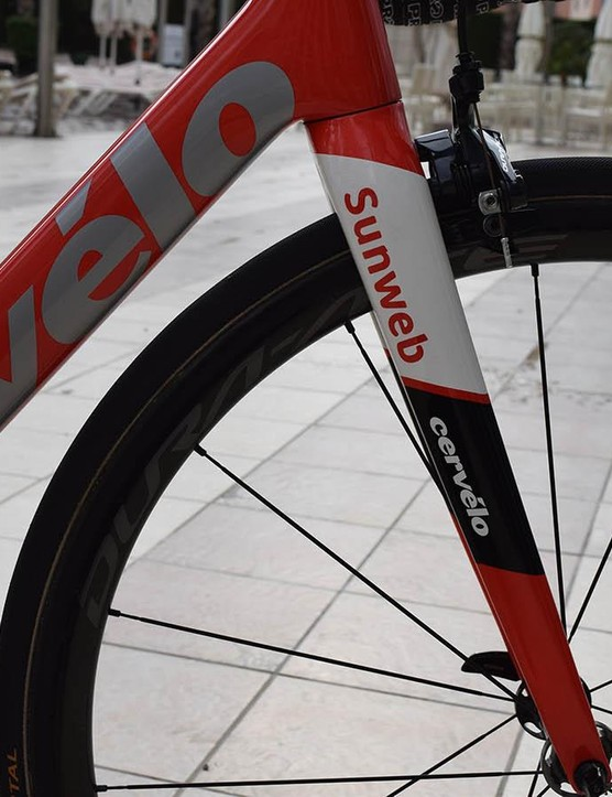 A red to white fade on the down tube is overlaid with silver Cervelo decals