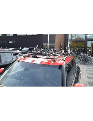 The roof rack has enough room for nine team bikes