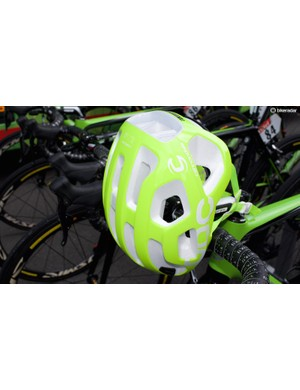 The helmet features a distinctive white EPS inner