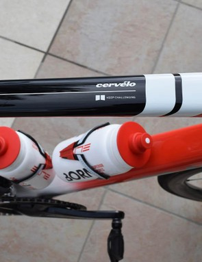 White bands feature across the top tube of the frame