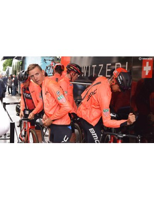 BMC Racing wore lightweight, orange rain jackets ahead of stage 1 from kit providers Assos