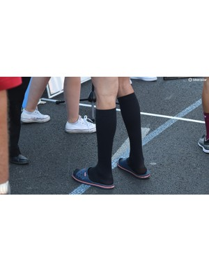 Several riders opt to wear compression socks ahead of stage starts throughout the week