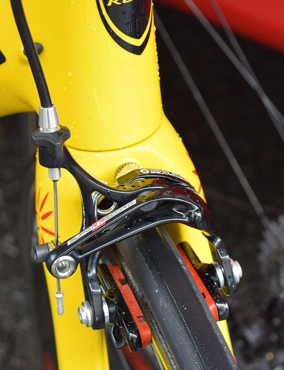 Carbon rim specific brake-pads double up as colour-coordinated accessories for the red and yellow custom frameset