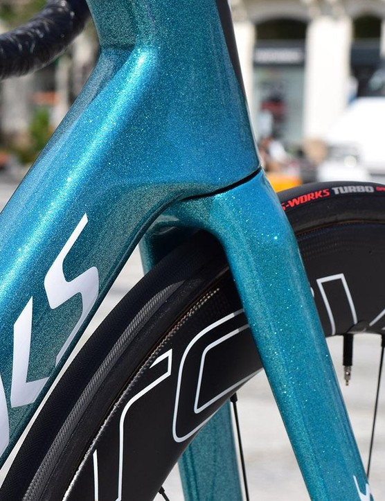 The teal-glitter design in the paint design catches the light