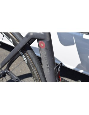 A raw carbon finish has subtle glitter-grey decals