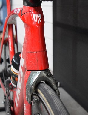 The Trek Madone features an integrated aero flap for the front brake that reduces wind resistance and still allows movement via a springed hinge