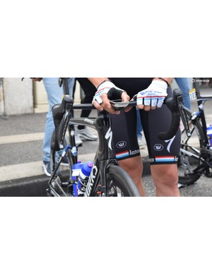 Bob Jungels pairs his computer and power meter ahead of stage one in the national chmapion colours of Luxembourg
