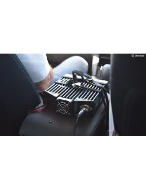 The race radio is attached to the centre console via some toe straps
