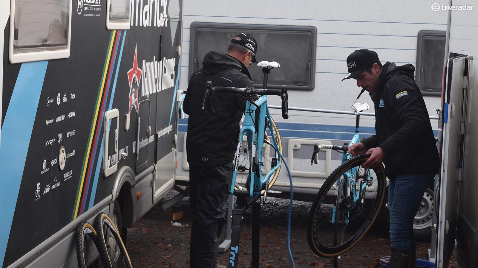 Mechanics from the Marlux-Napolean Games clean bikes after some warm up laps