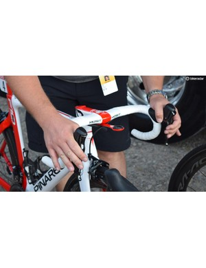 A Team Sky mechanic checks the brakes on Kwiatkowski's bike ahead of the stage