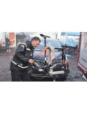 A mechanic prepares a Colnago Prestige for racing