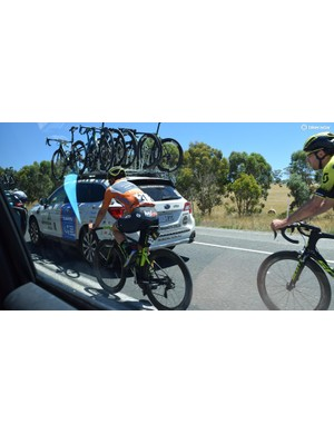 Current race leader Caleb Ewan (Mitchelton-Scott) is chaperoned back to the peloton by Jack Bauer