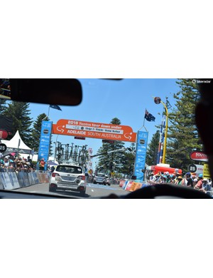 The race convoy passes through Victor Harbor on the final lap of the stage