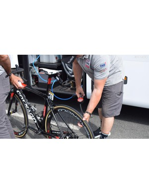 UAE Team Emirates have an air compressor and digital gauge on the team bus for easy tyre pressure setting