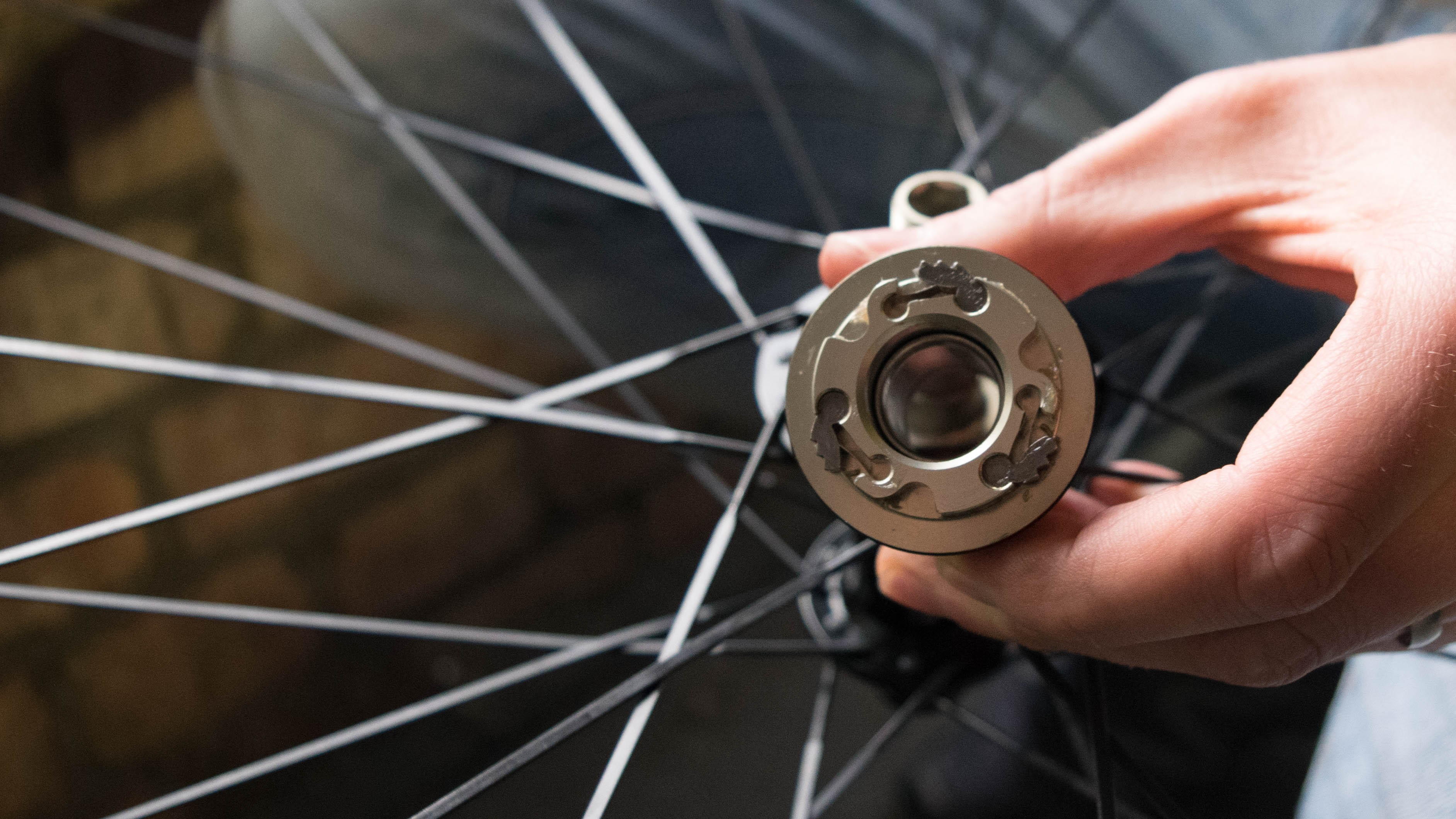 The freehub body has three pawls, each with an independently moving leaf spring, to spread the loads more effectively