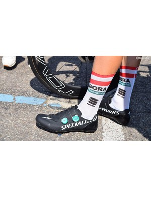 White Specialized decals on bike frames and shoes give the American brand extra exposure on the road side during races
