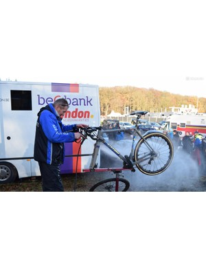 Former cyclocross world champion, Tour de France stages, Flanders and Liege-Bastogne-Liege winner, and Van der Poel's father Adri cleans his son's bike after warming up