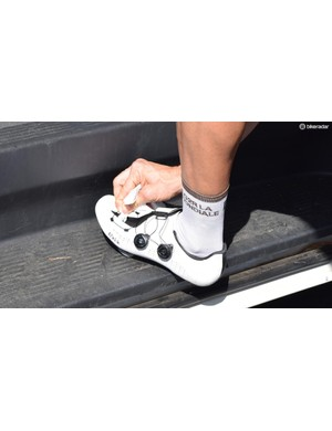Several riders would take a few moments ahead of the stage to clean up their shoes each day