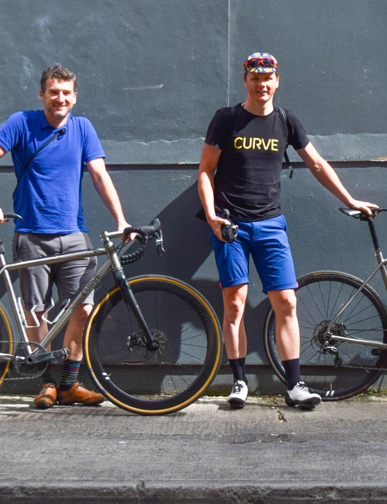 Curve Cycling's Adam Lana (left) and Ryan Flinn, with the bikes they rode over from France