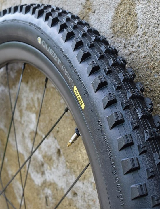 The tyre is dual compound, with a faster-rolling harder central tread and grippy shoulder knobs