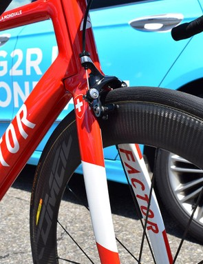 The red and white design for the Swiss champion stands out among the light blue bikes of Dillier's teammates