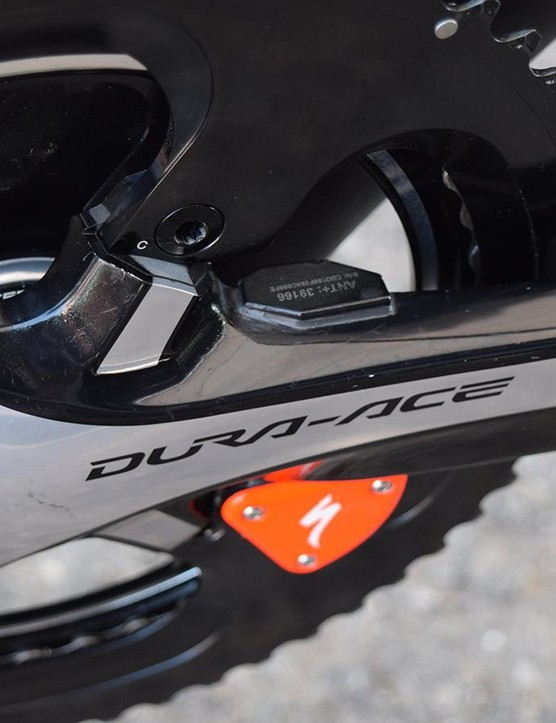 A close up look at the Specialized power meter, a few other pro bikes have also been seen with a fluoro orange hardware cover